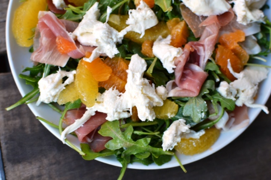 Arugula salad with citrus, burrata, and prosciutto